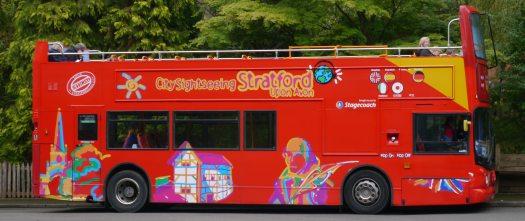 Irridescent tour bus in Stratford-upon-Avon.